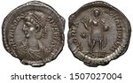 Small photo of Ancient Roman Empire silver coin miliarense 402-423 AD, ruler Theodosius II, draped bust of Emperor in diadem left, standing Emperor holding sphere in left hand, nimbus above head