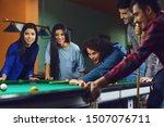 Friends Play Billiards In Bar.