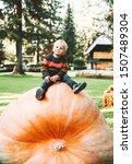 Smiling Boy Sits On Huge Size...