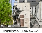 Small photo of AUSTIN, TEXAS, USA - March 17, 2019: Sculpture of Willie Nelson in Austin Texas. He is a country music legend born i Abbot, Tx.