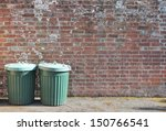 Dustbins Outside Against Brick...
