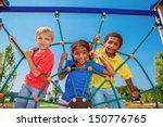 friends climbing the net at the ... | Shutterstock . vector #150776765