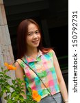 portrait of teen asian woman. | Shutterstock . vector #150792731