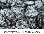 Small photo of Texture background, pattern. Dried fruits. the sweet and fleshy product of a tree or other plant that contains seed and can be eaten as food. desiccated, exsiccated, roughage