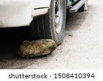 Large Stone Behind A Wheel Of ...