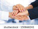 united hands  on office... | Shutterstock . vector #150868241