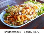 herb salad with deep fried fish ... | Shutterstock . vector #150877877