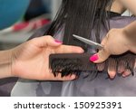 Hairdresser Cutting Client's...