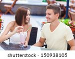 happy couple in love in cafe | Shutterstock . vector #150938105