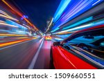 View from Side of Car moving in a night city - stock photo