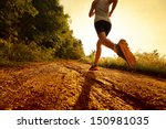 young lady running on a rural... | Shutterstock . vector #150981035