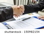 Business person shaking hands as a deal done - stock photo