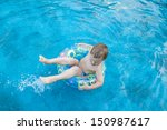 four year old boy in swimming... | Shutterstock . vector #150987617