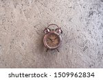 Small photo of Clock at 10 O`clock in the morning with vintage style alarm clock golden wooden background. Windup Type Alarm Clock. Home office. Copy space