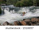 A Kayaker Battling Strong...