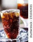 a glass of cola with ice cubes | Shutterstock . vector #151032431
