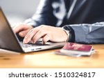 Small photo of Man with passport and laptop. Travel document and identification. Immigrant writing electronic application for citizenship. Apply for digital visa. Online flight ticket or web check in.