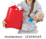 closeup on credit card in hand... | Shutterstock . vector #151034165