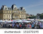 Autun,France-June 07,2013: View at the open air market in Autun,France. This market is held on mornings in front of the city hall at the  place du champ de mars  . June 7,2013 Autun, France  - stock photo