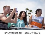 young people in a car having...   Shutterstock . vector #151074671