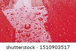 Raindrops On Red Car Hood ...