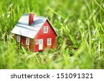 tiny red house in green grass | Shutterstock . vector #151091321