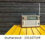 old radio on yellow table  | Shutterstock . vector #151107149