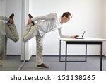 leg exercise durrng office work ...   Shutterstock . vector #151138265