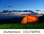 Orange Tourist Tent Stand On...