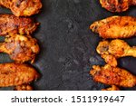 Fried chicken wings. Chicken wings on a dark background on a blackboard. Barbecue meat, grill.  Appetizing fried meat. copy space.