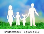 family from paper on grass on... | Shutterstock . vector #151215119