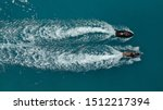 Aerial drone top down photo of 2 men competing in jet ski watercraft in high speed in Mediterranean popular destination deep blue sea