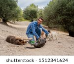 Stock photo professional dog walker or pet sitter with a pack of cute different breed and rescue dogs enjoying 1512341624