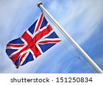 A Union Jack Flag Flying In A...