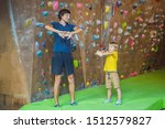 Dad And Son At The Climbing...