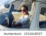 Woman Pilot Sitting In Cabin O...