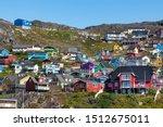Colored houses on rocky hills in Qaqortoq, Greenland.