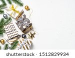 Christmas background with present box and decorations on white background. Top view with copy space. - stock photo