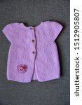 knitted wool baby cardigan over ... | Shutterstock . vector #1512905807