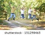 happy family outdoors | Shutterstock . vector #151298465