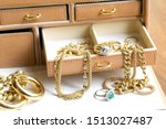 Closeup Of Gold Jewelery With...