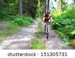 cyclist girl on mountain bike... | Shutterstock . vector #151305731