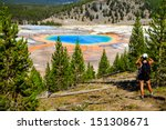 A hiker looking down on Yellowstone National Park