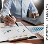 Small photo of strategy analysis concept, Businessman working financial Manager Researching Process accounting calculate analyse market graph data stock information review on the table in office.