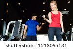 Small photo of Portrait women and man wearing tightening workout are lifting dumbbell. To build muscle upper arm to tighten in gym which is a set to help keep the body healthy. concept health care and sport