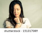young woman pulling her hair... | Shutterstock . vector #151317089