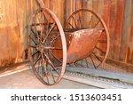 An Old Antique Wheelbarrow...