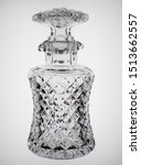 Small photo of Antique cut glass decanter seen against a featureless background