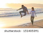 young couple enjoying a walk on ... | Shutterstock . vector #151405391