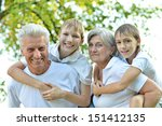 cheerful family standing on a... | Shutterstock . vector #151412135
